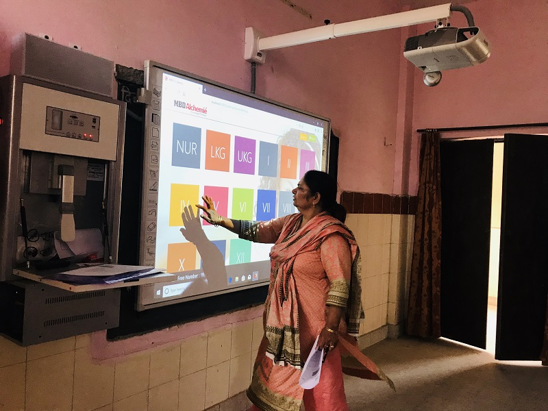 Teachers using digital teaching system at school