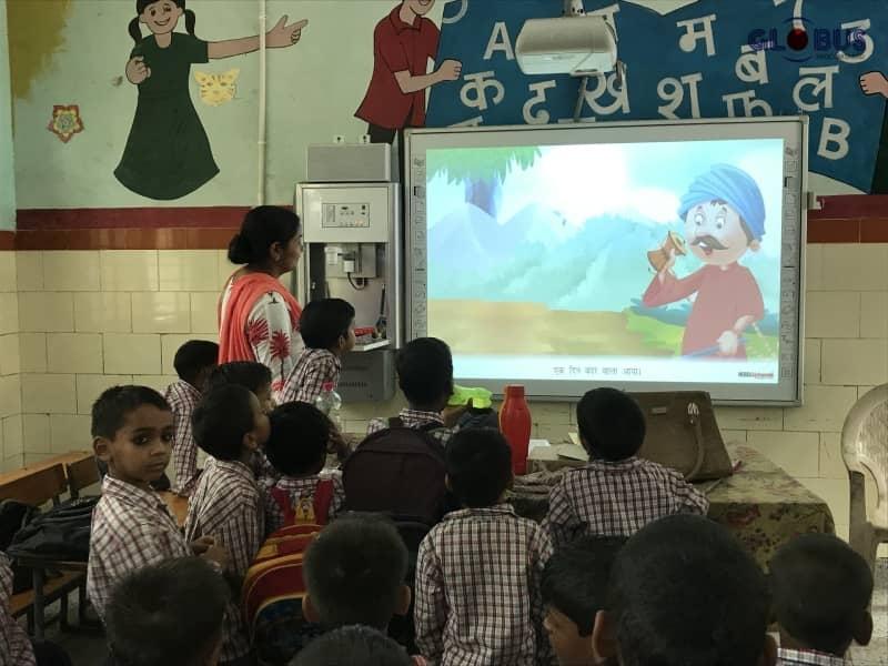 teacher using interactive whiteboard in classroom