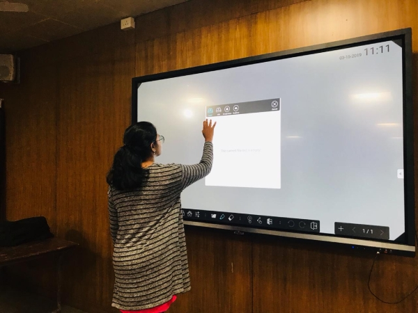 Student learning on Interactive Display in school