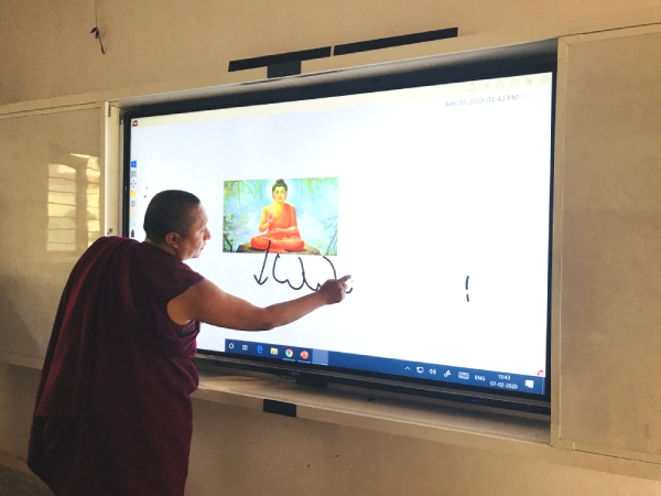 Teacher using interactive display in university
